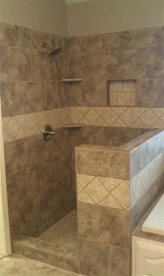 Walk in shower, tile to ceiling and plants