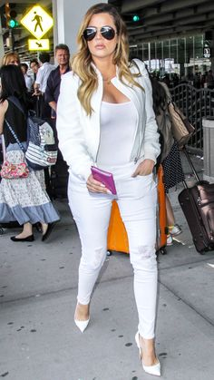 KHLOE KARDASHIAN The youngest Kardashian sister took the guesswork out of her travel outfit by choosing an all-white ensemble. Her distressed skinnies are casual while the pumps add some glamour.