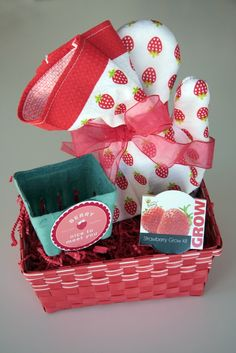 i think a cute strawberry basket like this filled with strawberries and a loaf of panera bread would be sweet.