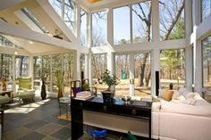 Walls of glass and soaring ceilings at 27 Varick Hill Road, Newton, MA.  Offered by Steinmetz Re Professional Group http://www.raveis.com/mls/71369245/27_varick_hill_road_newton_ma/#