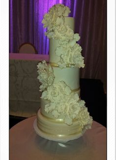 Six tier wedding cake adorned with gumpaste peonies and 24k gold accented petals #fabulousandfauxweddingcakes www.fabulousandfauxweddingcakes.com
