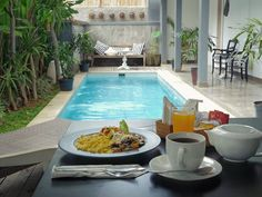 #breakfast by the pool. Tap  @SummerhomeBnB and spend your holiday with them by foodcious
