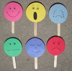 Emotion faces with paper, popsicle sticks, and glue/tape.