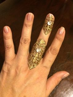 Ring and finger tip set of 2 pieces gold color filigree adorned with clear swarovski crystals by pickapicka on Etsy https://www.etsy.com/listing/212248231/ring-and-finger-tip-set-of-2-pieces-gold