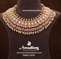 22 carat heavy necklace studded with pink, green and white kundans adored with gold balls and pearls byAmarsons Pearls & Jewels. rubies emeralds designer heavy kundan necklace designs in 20 grams, 30 grams, 60 grams necklace designs, in white stones with pearls drops