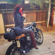 Misty Whitten and her vintage 1977 BMW r100/7 motorcycle all packed up for a camping trip.