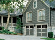 Steel Carriage Doors Wayne-Dalton Model 9700 sectional steel garage doors that are rugged, low-maintenance, and insulated. They are pre-finished in Eurowhite, gray, green, or clay.