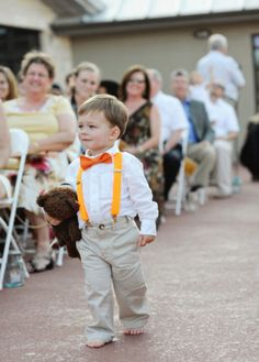 Ring bearer with  colored suspenders... too cute :)