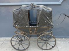 This possibly has to be the oldest pram in our possession. It is circa 1850 and was made to resemble an actual coach with the two hoods and a false door sitting on the original designed coach leaf springs and wooden wheels. This would possibly originally have been pushed by a lady wearing a crinoline!