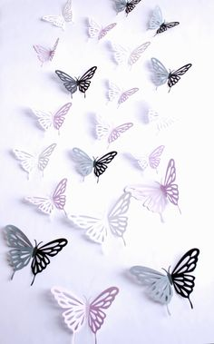 3D paper butterfly with cutouts, wall sticker, room decor, baby nursery, in black white and lilac 20 pieces. $35.00, via Etsy.