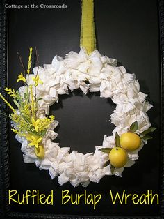 Ruffled burlap wreath decorated with lemons and flowers in a twine-tied burlap pouch. Super cute!