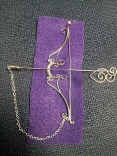 Beautiful wire bow and arrow by #JulieDarrington