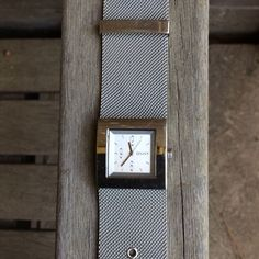 DKNY WATCH SALE FROM 25 to 15.00  GREAT DEAL!!  Beautiful silver DKNY watch.  It has a wide metal band and has rarely been worn. It is in GREAT CONDITION. It does need a new battery  you really can't go wrong with such a quality watch and a GREAT NEW PRICE 15.00. THERE ARE A FEW SCRATCHES ON THE BACK OF THE WATCH (See Pic)ALSO 1 small scratch (not very noticeable) on front, but not on crystal!  Please GIVE IT A GOOD HOME!  DKNY Accessories Watches