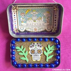 """A Dia De Los Muertos Altoid tin shrine made by yours truly. I will more that likely add a few more little """"baratijas"""" as I find or make them but for now…Estoy acabado."""