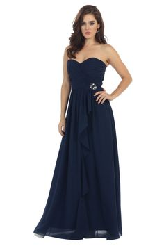 An elegant strapless sweetheart dress with a ruched bust and a hip broach…