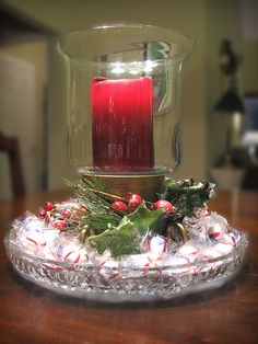 Christmas Super Easy Centerpiece...I like the height the candy gives the hurricane, so doing this!