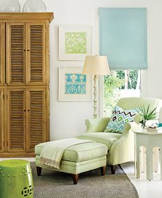 Plush, elegant furnishings decorated in blue, green, and white