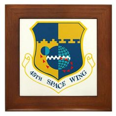 """45th Space Wing Framed Tile by CafePress by CafePress. $15.00. Quality construction frame constructed of stained Cherrywood. Two holes for wall mounting. 100% satisfaction guarantee return policy. Rounded edges. Frame measures 6"""" X 6"""" x 0.5"""" with 4.25"""" X 4.25"""" tile. 45th Space Wing Shoulder Sleeve Unit Insignia, SSI"""