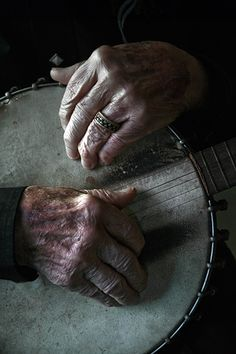 Photo Credit: Jim Herrington. Ralph Stanley's fingers rest on his banjo, which has traveled everywhere from coal mining camps to gin joints to Carnegie Hall.