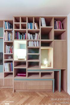 Restructuration d'un appartement avec ajout d'une chambre, et création d'une zone repas repliable dans la bibliothèque