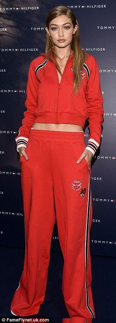 Gigi Hadid, 21, flashed her washboard abs in a sports-chic inspired ensemble at the Tommy Hilfiger store in Milan to present her Tommy x Gigi fashion collection on Saturday.