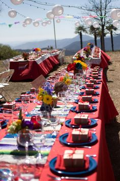 fiesta themed reception or party, mexican blanket table runners, flowers in clay jars, bright colors!