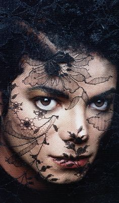 This was sppsd to b the album cover of BAD, inspired by an old early 1900's vogue magazine cover where they cover the lens with black lace, but michael felt thi picture didnt exactly fit the look he wanted for BAD