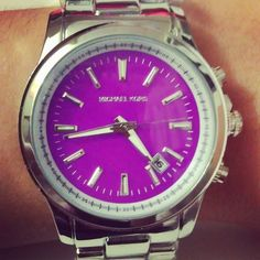 Michael Kors purple faced watch.
