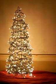 tree made out of Christmas lights and an upside down tomato cage