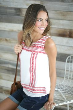 We're loving spring's newest embroidery trend! This red and white contrast tank is sweet and firey!
