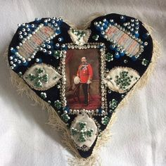Early Century Soldier's Sweetheart Pin Cushio~Image via MaRoDeco Fabric Hearts, Fabric Yarn, Craft Accessories, Antique Quilts, Pincushions, Textile Artists, Heart Art, Vintage Sewing, Heart Shapes