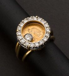 mexican peso ring with floating diamond !
