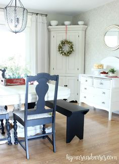 Love this eclectic dining room with painted furniture, blue chairs and old bench eclecticallyvintage.com