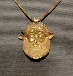 Achelous head. Pendentive of an Etruscan gold necklace, ca. 480 BC. From Chuisi? Louvre Museum