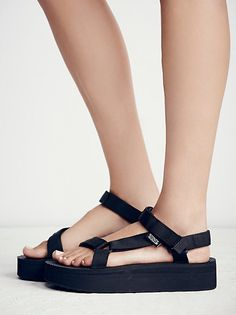 Universal Flatform Teva   Take the classic Universal Teva and add a flatform to get this super cool and updated style. Comfortable and easy to wear with adjustable straps.