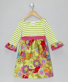 Perfect for brightening any day, this dress combines a babydoll silhouette with fun fabric patterns. The knit bodice and back tie give it a comfy fit too.