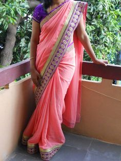 Code: RS007 --- Peach georgette saree finished with purple and gold borders. --- Blouse: Purple banaras fabric --- Price: INR 3250 --- Please mail us at ramanisarees@gmail.com
