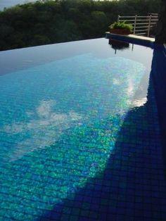 Turquoise glass tiled infinity pool