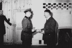"""Adolf Hitler awards Kurt Meira Oak Leaves to the Knight's Cross . """" Werewolf"""" , February 25, 1943 ."""