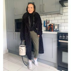 Layering for winter - leather jacket and shearling coat | Photo shared by Abi | For more style inspiration visit 40plusstyle.com