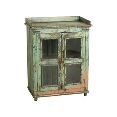 Green & pink cabinet - We travel through India to find to most beautiful and unique cabinets. Without losing the story of their past we fix the cabinets where necessary, while keeping them as original as possible. Our mission is to pass them on to a new home where they will be appreciated for many years to come.