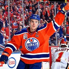 Connor McDavid of the Edmonton Oilers celebrates after scoring a goal during the season opener against the Calgary Flames on October 12 2016 at. Women's Hockey, Hockey Girls, Hockey Stuff, Connor Mcdavid, Hockey Quotes, Nhl News, Pittsburgh Penguins Hockey, Edmonton Oilers, National Hockey League