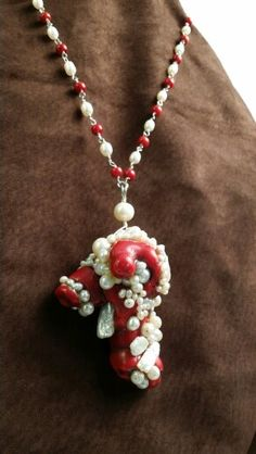 Large red coral pendant trimmed in fresh water pearls wired with sterling silver Argentium wire. By Jenny Carlile / Divine Jewels.