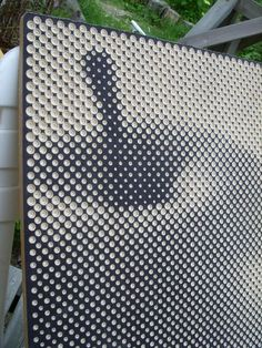 Craftsman Tomi engraved thousands of holes on plywood to create halftone images. The board (at top) was made as a birthday gift for his brother. Photos © Tomi Link via Art Sponge
