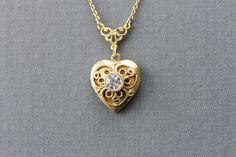Vintage 1928 Jewelry Company Heart Locket Necklace gold Valentines Day bling. $25.00, via Etsy.