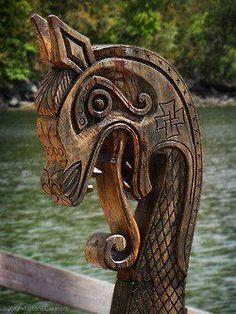 Dragon head on modern day viking ship recreation.