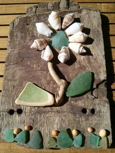 I love to collect driftwood, sea glass and Sea pottery and create air work. Sea side art design by Philippa Komercharo.