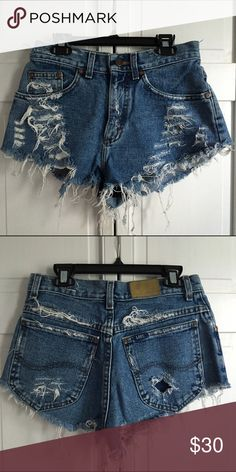 High waisted denim shorts High waisted denim shorts! Distressed. (Quite short) Waist - 27; Rise - 10; Length - 9 (not nasty gal, for exposure) Perfect beach shorts! Nasty Gal Shorts Jean Shorts