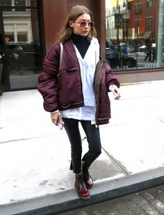 Gigi Hadid Photos Photos - Model Gigi Hadid was leaves her apartment in New York City, New York on February She wore a red jacket, white shirt, and black leggings. - Gigi Hadid Steps Out In NYC During Fashion Week Gigi Hadid Outfits, Gigi Hadid Style, Fashion Now, Daily Fashion, Fashion Outfits, Sports Illustrated, Black Leggings, Bomber Jacket, Women Wear