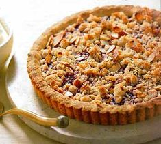 Raspberry Jam Tart with Almond Crumble... one of my favorite recipes that I make! Everyone always loves it because its so different from the sea of chocolate on a dessert table.